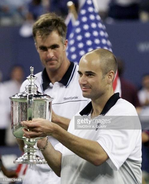 Number two seeded Andre Agassi of the US holds the US Open trophy after his victory over compatriot and number seven seeded Todd Martin 12 September...