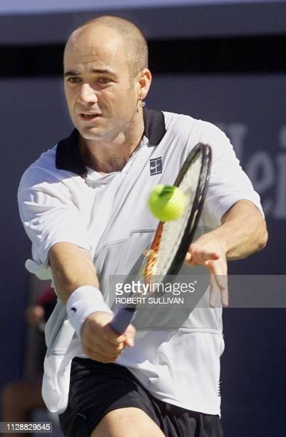 Number two seeded Andre Agassi of the US returns a backhand to number three seeded Yevgeny Kafelnikov of Russia 11 September at the US Open in...