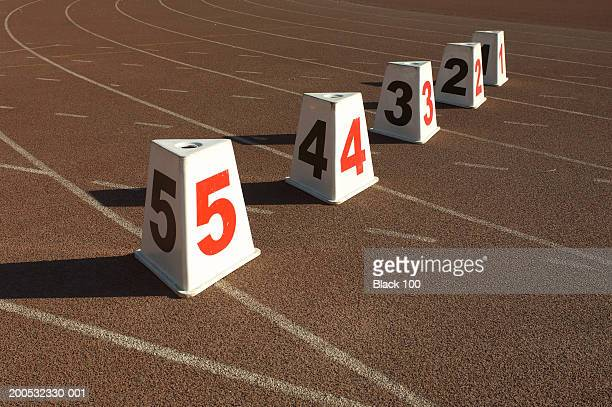 Numbered lane markers on running track