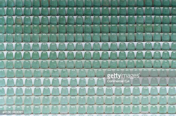 numbered seats in stadium - empty bleachers stockfoto's en -beelden