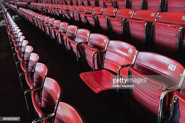 numbered stadium seats - empty bleachers stockfoto's en -beelden