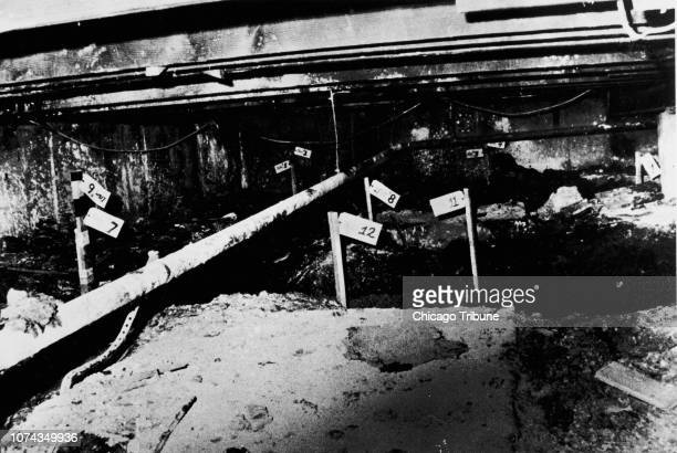Numbered stakes indicate where the bodies of John Wayne Gacy's victims were found in the crawl space beneath his suburban home Twentynine bodies all...