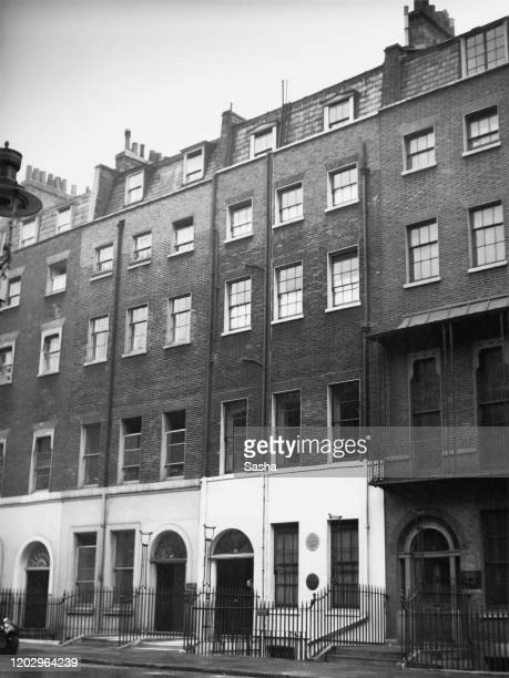 Numbers 22 and 20 Queen Anne's Gate in Westminster London 27th May 1936 Number 22 has a blue plaque commemorating Prime Minister and former resident...