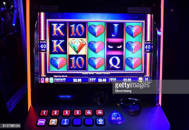 Numbers and symbols are displayed on the screen of a poker machine in the gaming room at the Vikings Club in Canberra Australia on Monday Sept 26...