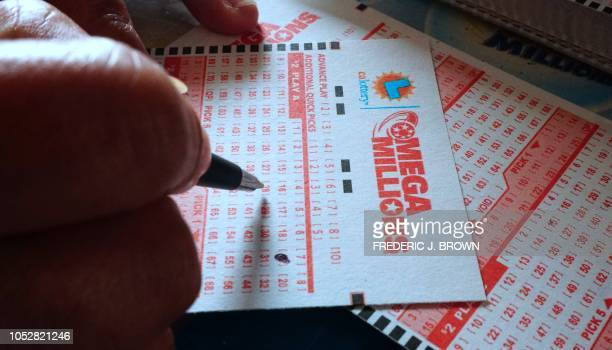 Numbers are selected on a Mega Millions lottery ticket in Los Angeles California on October 23 2018 The Mega Millions jackpot now reaching 16 billion...
