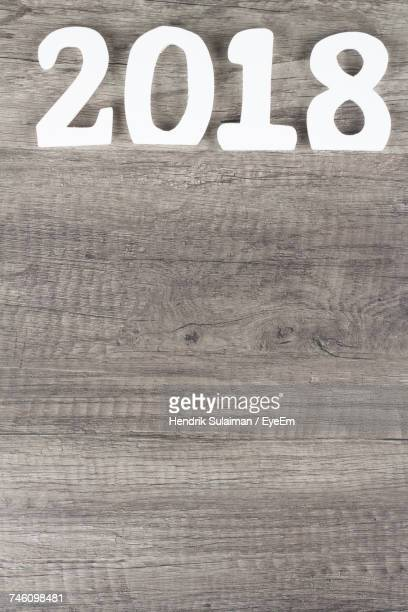 numbers creating year 2018 on wooden surface - 2018 - fotografias e filmes do acervo