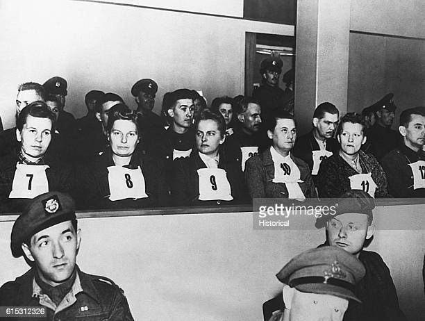 Numbers identify prisoners in the dock during a war crimes trial in Luneberg Germany Among the prisoners are a number of women including Elizabeth...