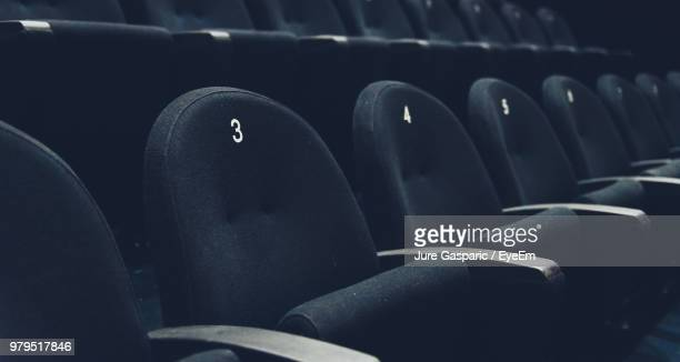 numbers on black seats at movie theater - auditorium stock pictures, royalty-free photos & images