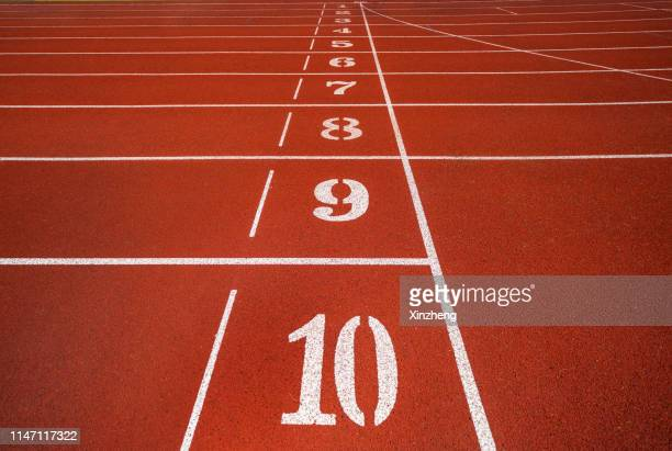 numbers on running track - track and field stadium stock pictures, royalty-free photos & images