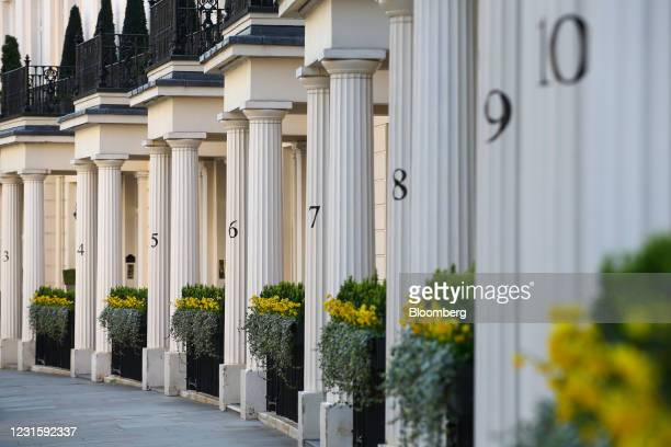 Numbers on the columns of townhouses in Belgravia, London, U.K., on Sunday, March 7, 2021. Sales of luxury properties tumbled 13% as the pandemic...