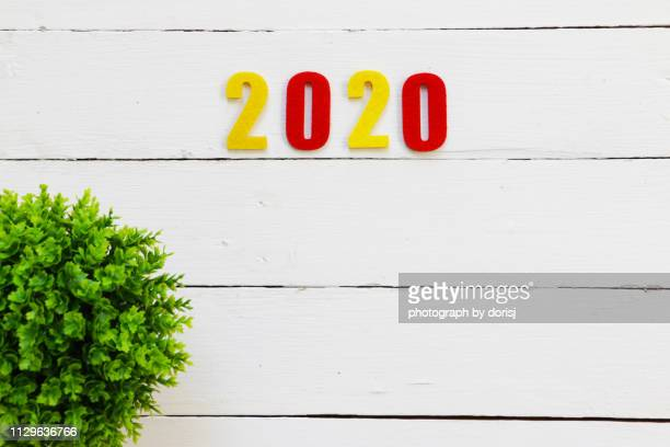 numbers on white wooden background - 2020 calendar stock photos and pictures