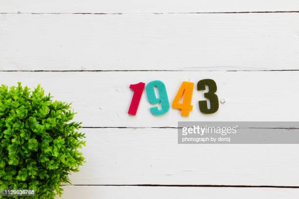numbers on white wooden background - 1943 stock pictures, royalty-free photos & images