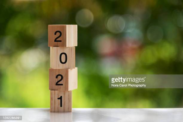 2021 numbers on wood blocks new year concept - 2021 stock pictures, royalty-free photos & images