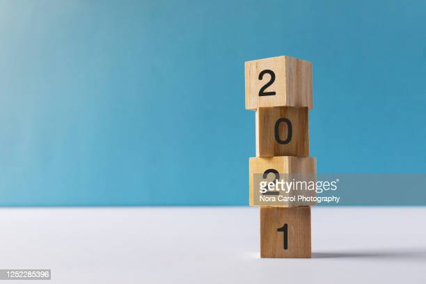 2021 numbers on wood blocks new year concept - number stock pictures, royalty-free photos & images