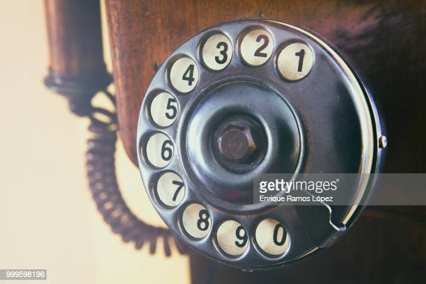Numbers on wooden retro telephone