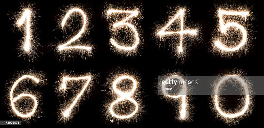 Numbers written with a sparkler : Stock Photo