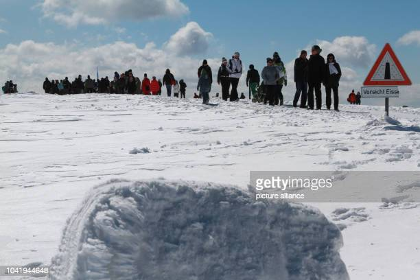 Numerous hikers walk towards Brocken mountain in bright sunshine near Schierke Germany 01 April 2013 The highest point in the Harz mountains was a...