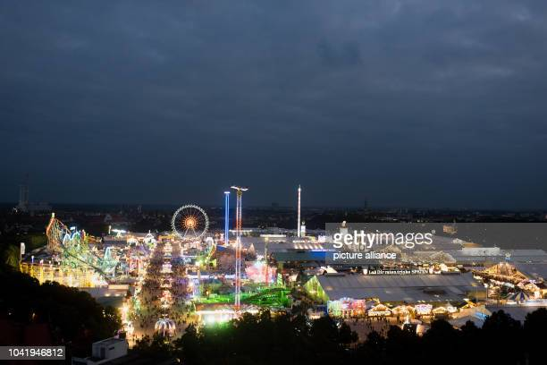 Numerous illuminated funrides and festival tents can be seen at night at the Oktoberfest in MunichGermany 21 September 2016 The 183th Wiesn take...