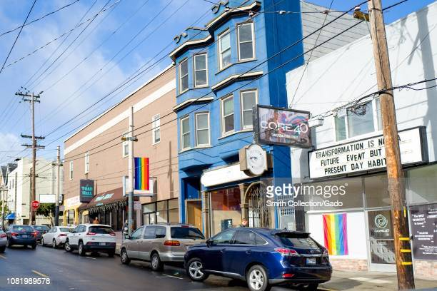 Numerous LGBT rainbow pride flags are visible on a sunny day on 18th street in the Castro District of San Francisco California known as one of the...