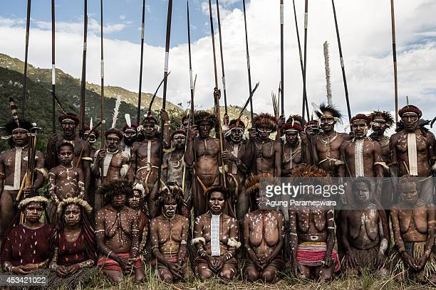 Numerous members of the Papuanese tribes group together for a portrait during the 25th Baliem Valley festival on August 8, 2014 in Wamena, Indonesia....