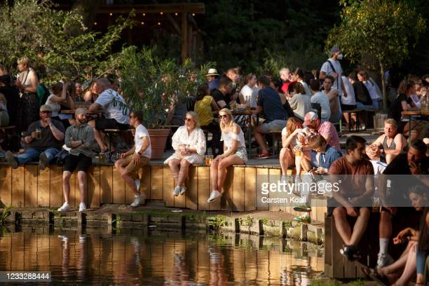 """Numerous people enjoy the sun in the beer garden in the """"Cafe am neue See"""" on the second day that people are no longer required to show a negative..."""