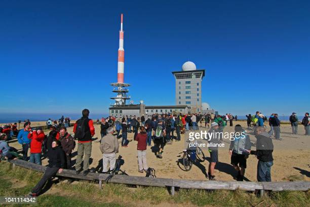 Numerous people visit the summit of Brocken Mountain in the sunny weather in SchierkeGermany 04 October 2014 The mountain is one of the most popular...