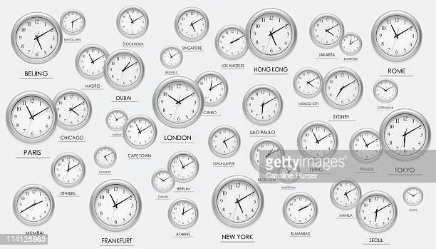 numerous scattered international clocks - cambio horario fotografías e imágenes de stock