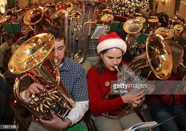 Numerous tuba players belt out Christmas songs during a concert December 21 2000 in the Palmer House Hilton''s hotel lobby in Chicago Over 310 tuba...