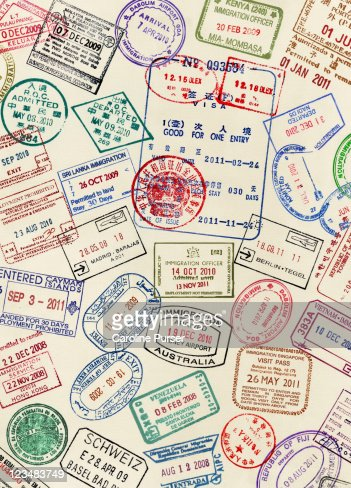 Numerous Visa Stamps On A Passport Page Stock Photo