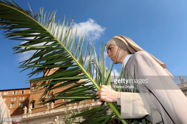 A nun arrives in St Peter's Square for the Palm Sunday Mass on April 14 2019 in Vatican City Vatican Palm Sunday commemorates the triumphal entry of...