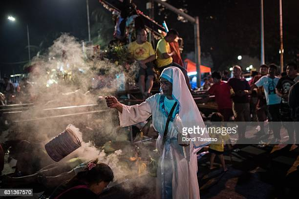 A nun blesses devotees during the procession of the Black Nazarene on January 9 2017 in Manila Philippines The Feast of the Black Nazarene culminates...