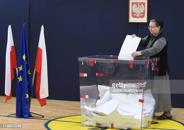 A nun casts her ballot to vote for the European elections in a polling station in Warsaw on May 26 2019
