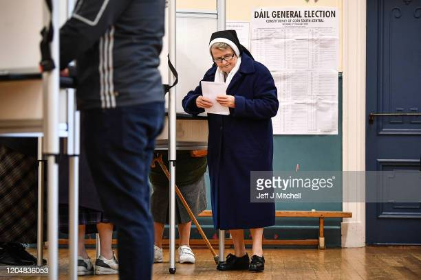 A nun casts her vote at Nano Nagle Hall in Ireland's national election on February 8 2020 in Cork Ireland Ireland has gone to the polls following...