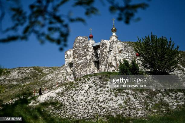 Nun climbs to the cathedral of the Saviour of the Holy Image in the 17th century monastery near the village of Kostomarovo, Voronezh region, on May...