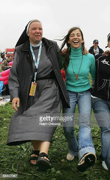 Nun dances with a girl at the Marienfeld at World Youth Day August 21, 2005 near Cologne, Germany. An estimated 900,000 pilgrims came to the...