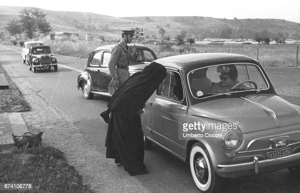 A nun doing hitchhiking in Rome 1957