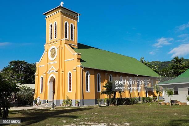 Nun entering church in La Passe on La Digue Island