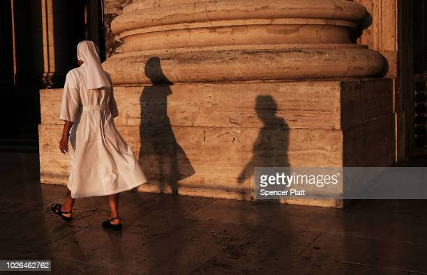 A nun enters St Peter's Basilica at dawn on September 03 2018 in Vatican City Vatican Tensions in the Vatican are high following accusations that...