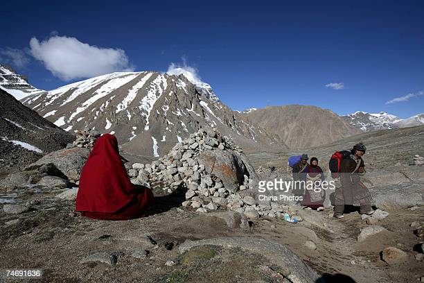 A nun from Nepal worships the snowcapped Kangrinboqe Mountain known as Mt Kailash in the West June 16 2007 in Purang County of Tibet Autonomous...