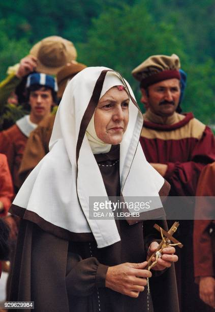 Nun holding a crucifix procession for the feast of St Rita Cascia Umbria Italy