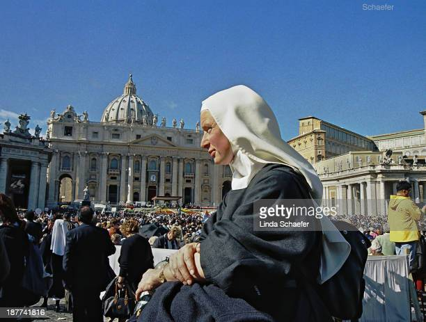 CONTENT] Nun honors Mother Teresa at beatification October 19 2003 where 300000 people were gathered to hear Pope John Paul II praise the work of...