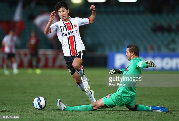 Nun IlLok of FC Seoul is tackled by Ante Covic of the Wanderers during the Asian Champions League match between the Western Sydney Wanderers and FC...