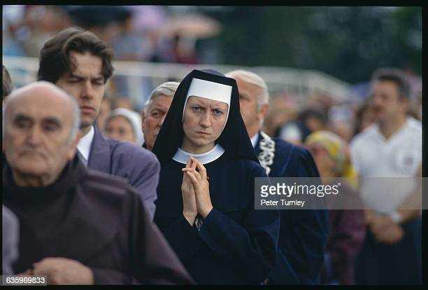 Nun in a Religious Procession