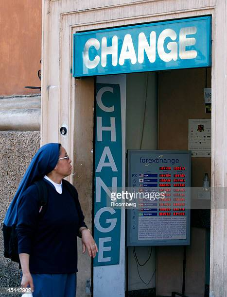 A Nun Looks Inside Bureau De Change Currency In Rome Italy On Wednesday May
