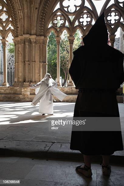 Nun meditating in sunlight, monk watching.