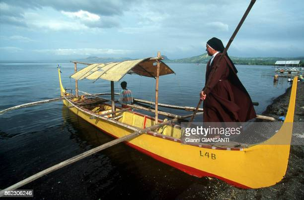 Nun on a bark on lake near Taal volcano 120 kilometers far from Manila in April 1994 in Philippines