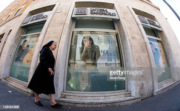Nun passes an Intesa Sanpaolo SpA bank branch in Rome, Italy, on Tuesday, July 17, 2012. UniCredit SpA and Intesa Sanpaolo SpA were among 13 Italian...