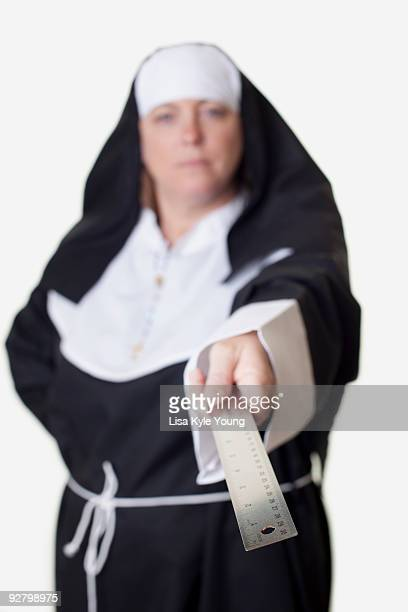 Nun pointing ruler