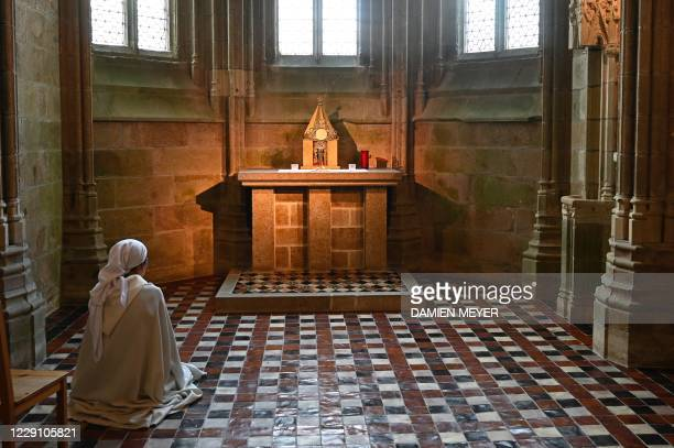 A nun prays at the abbey of MontSaintMichel northwestern France on October 16 2020