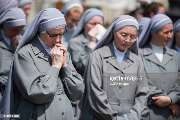 A nun prays druing the Corpus Christi procession in Krakow The Feast of Corpus Christi or Body of Christ is the Roman Rite liturgical solemnity...